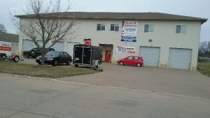 Two-story residential self storage facility with garage doors.