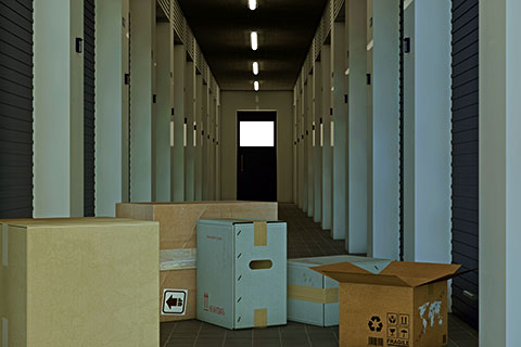 Interior storage units with boxes on the hallway floor.