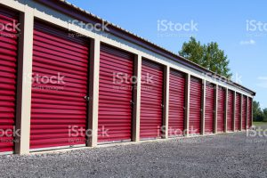 front of self storage unit with red doors